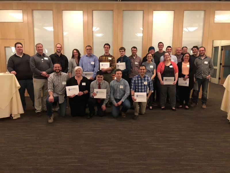 Students holding certificates at a University of New Hampshire boot camp