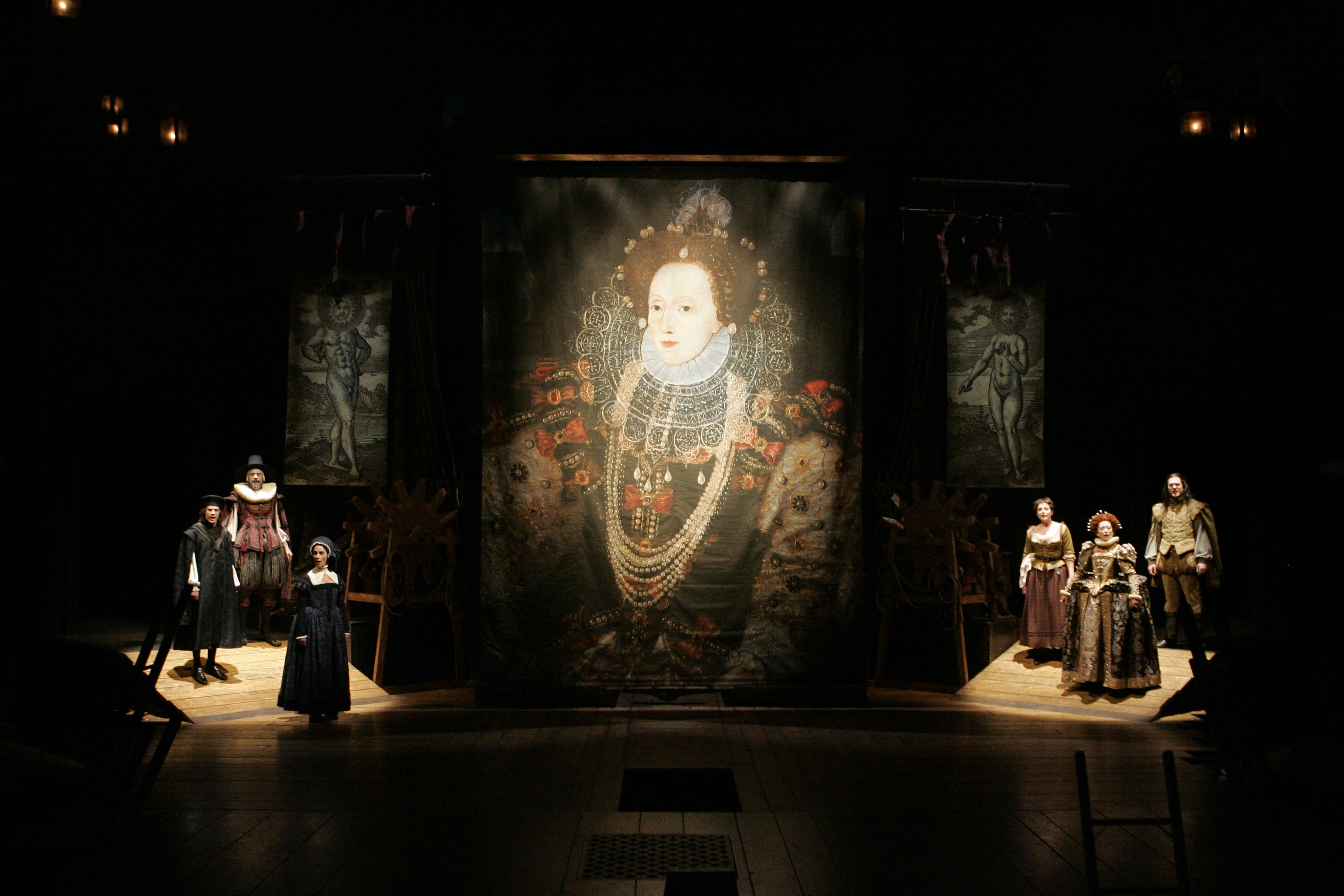 Giant portrait of Queen Elizabeth I with trios of Elizabethan-garbed characters on ramps flanking the sides.