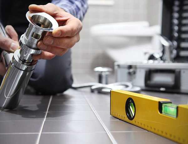 Plumber installing new toilet