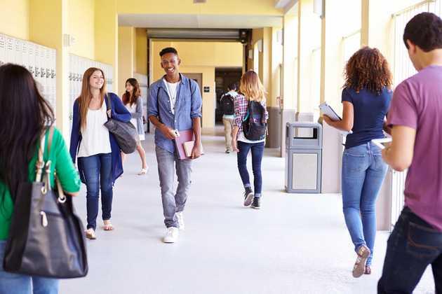Students walking in outdoor hallway