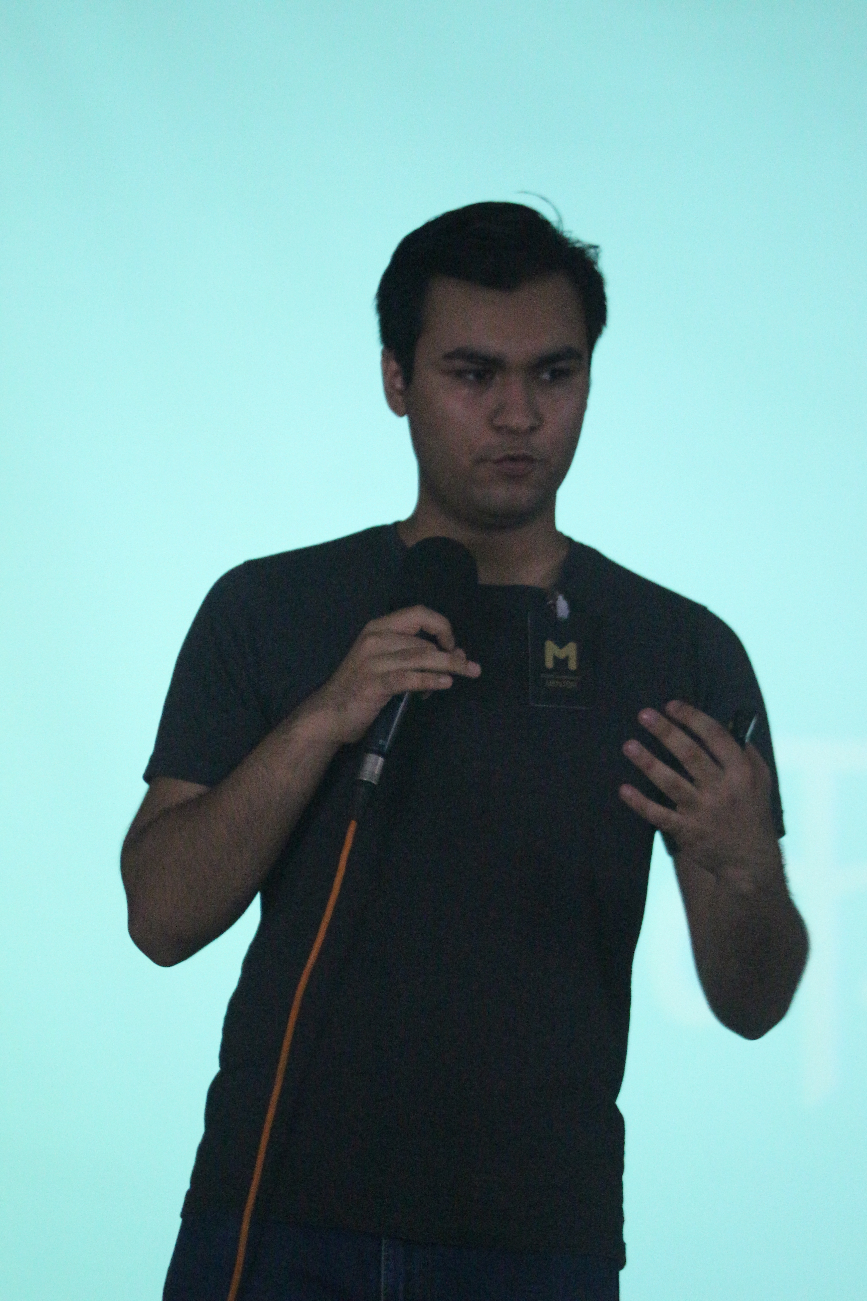 Anand Chowdhary speaking with blue background