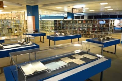 A photo of the National Library Donors' Gallery, with showcases in the foreground.