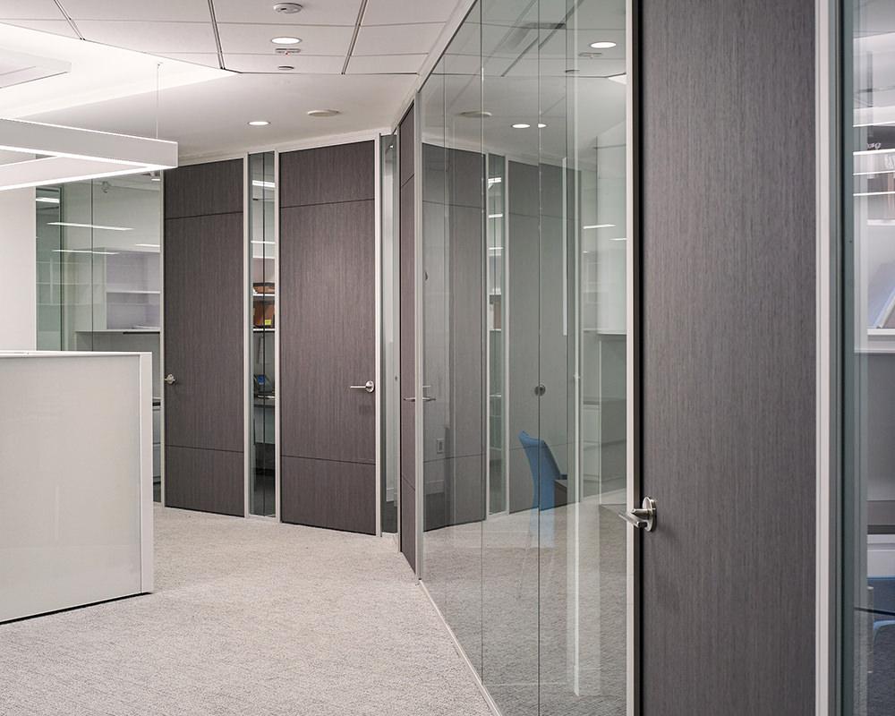 Hexagonal Hallway With Glass Panel Walls and Wooden Doors