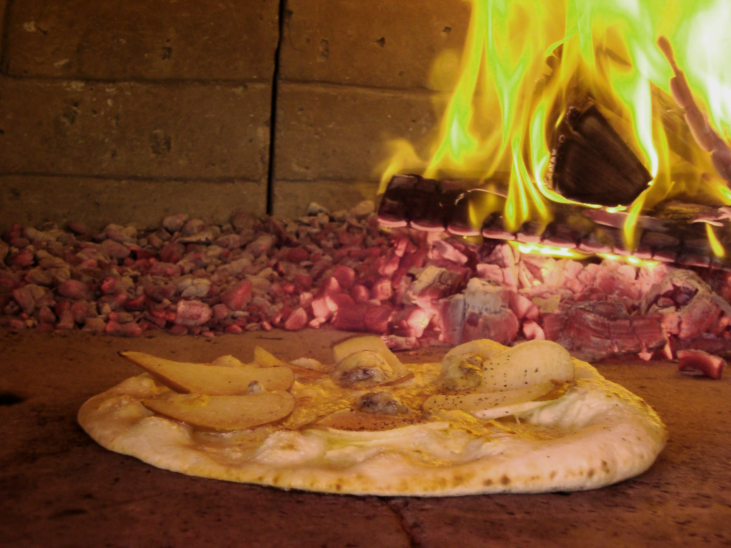 Pizza cooked in Auckland wood oven using Ti-tree