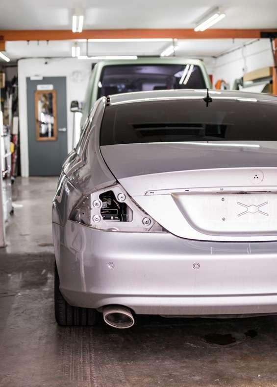 Grey Mercedes CLS car taken apart for vinyl wrapping