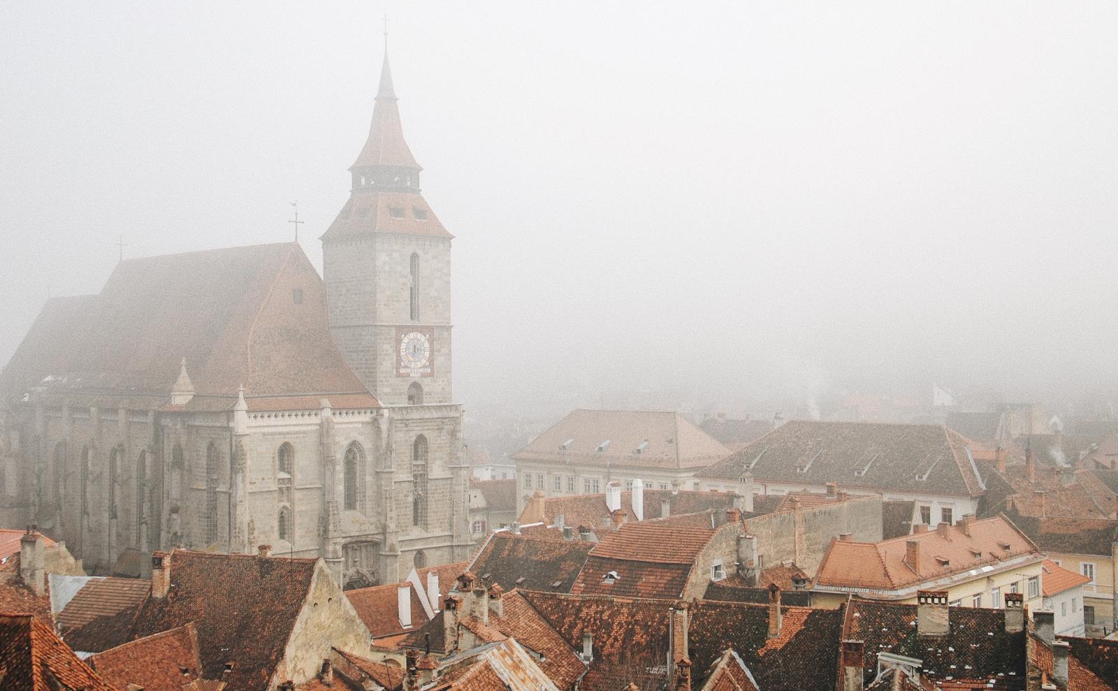buildings in the fog in brașov, romania