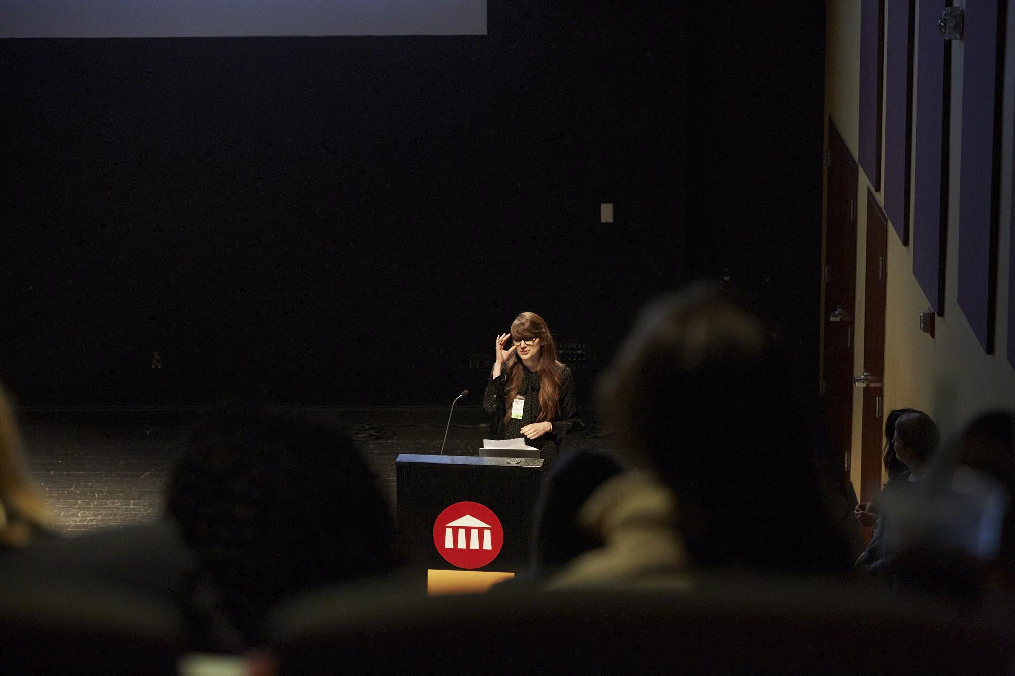 Photo of Joni Trythall at podium speaking