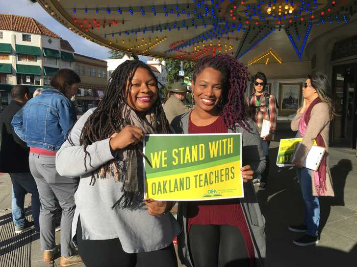 Canvassers stand with Oakland teachers