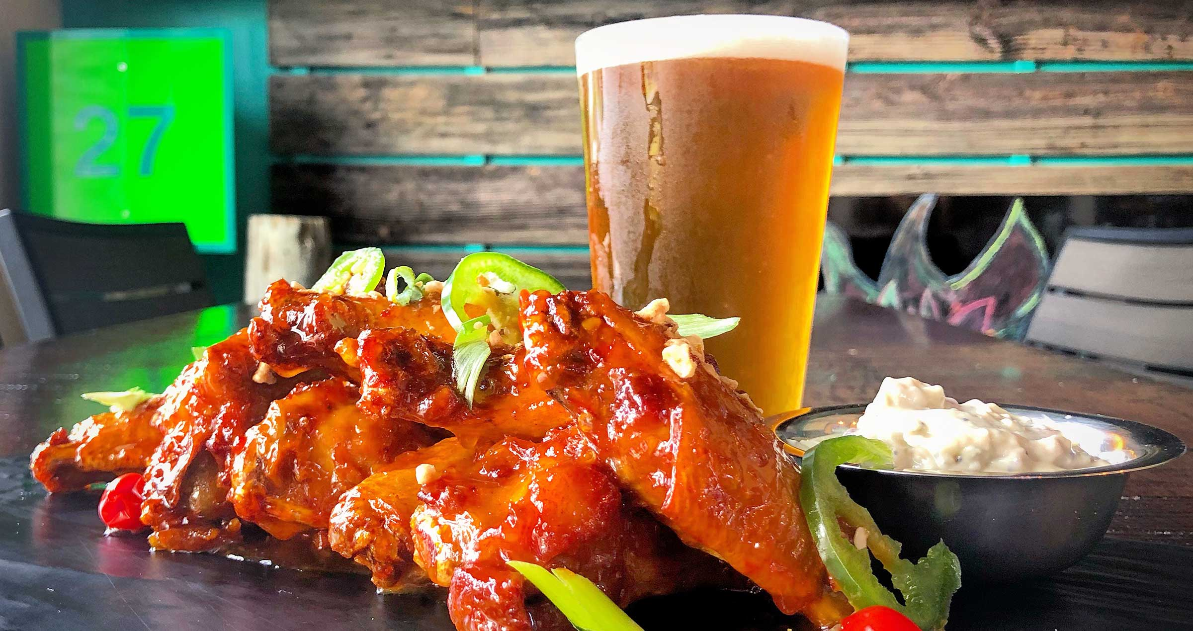 Fried chicken wings with blue cheese and a cold beer