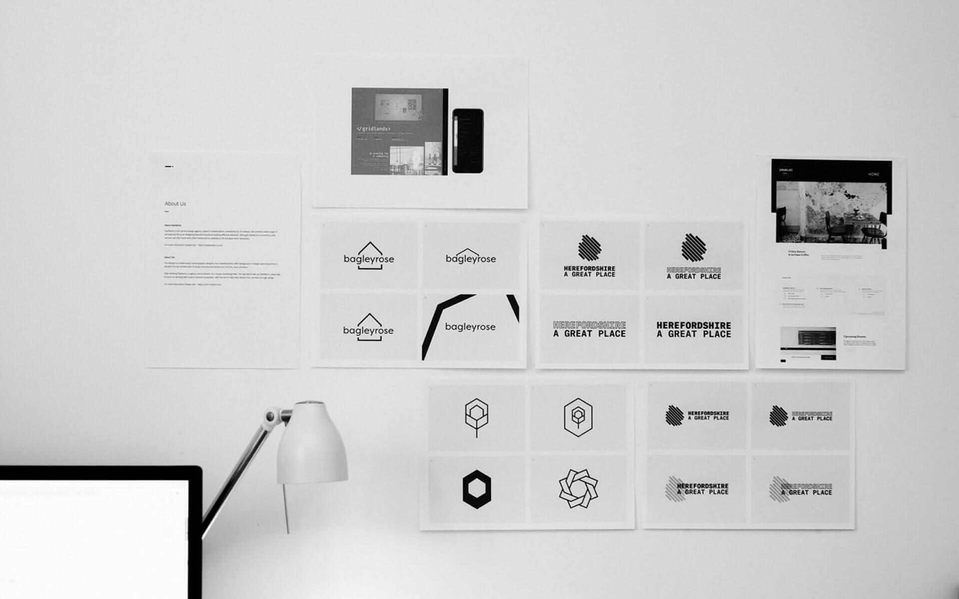 A collection of work in progress designs pinned to a wall.
