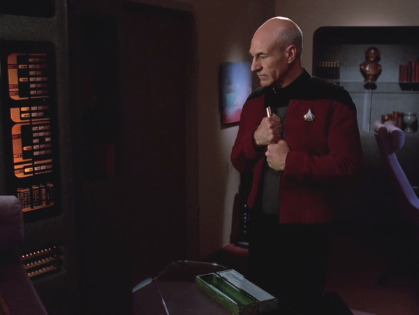 Picard with the Ressikan flute, back on board the Enterprise