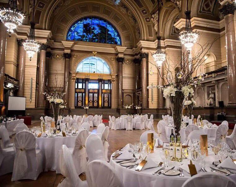 Grand wedding breakfast set in a large hall