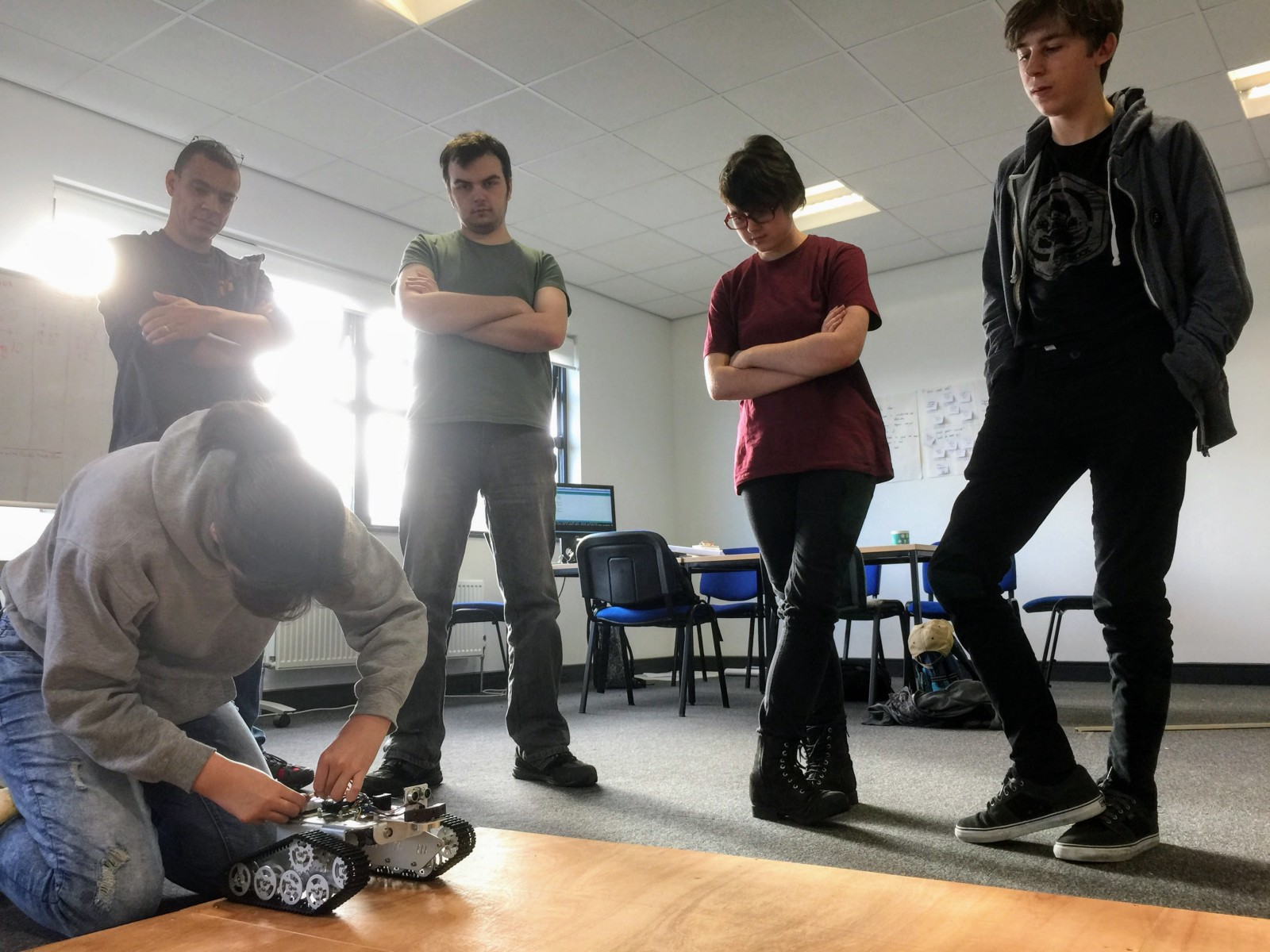 Team Indeciders test their code on the rover robots