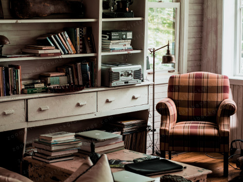 Cosy Home Study Virtual Background for Zoom with bookcase and armchair