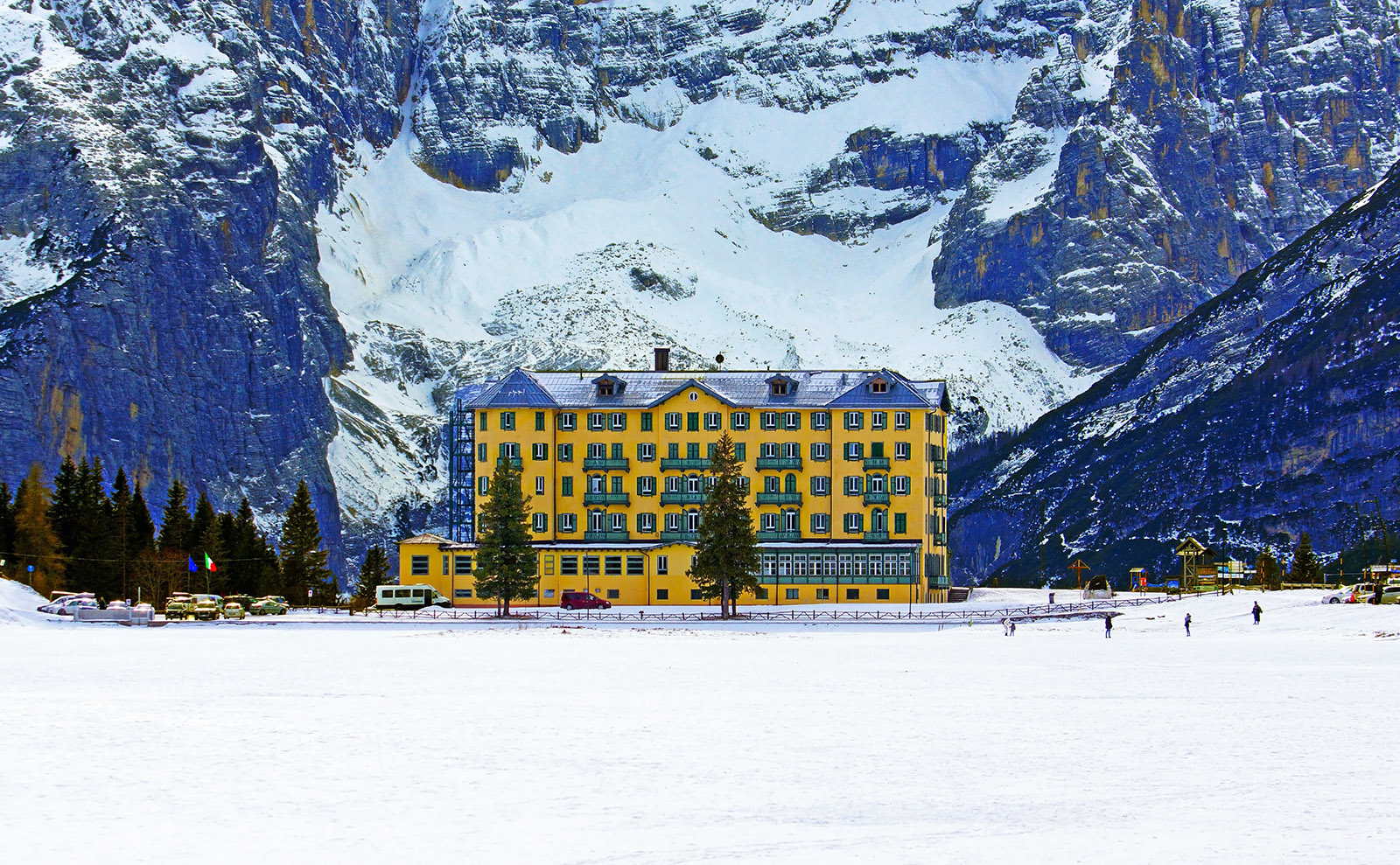 large yellow hotel on a snowy mountain