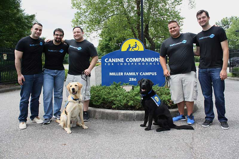 Group in front of sign with dogs