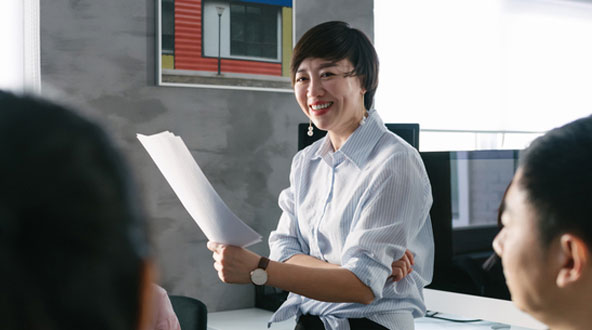 Smiling professional woman leading a meeting