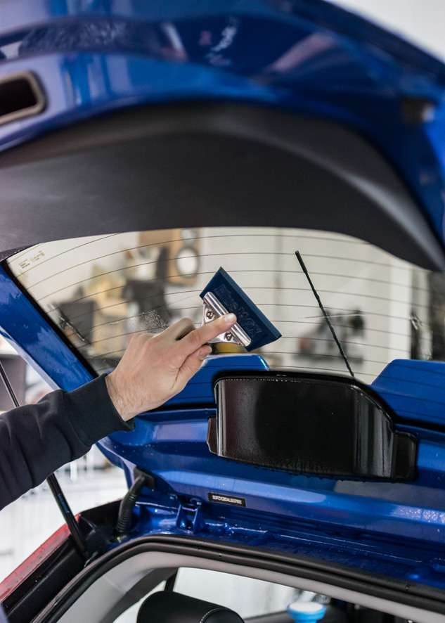Blue MG3 car rear window being tinted