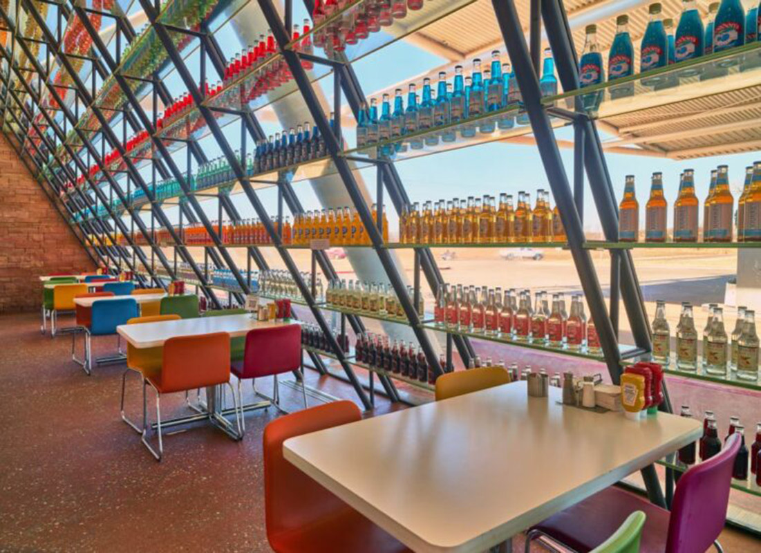 the inside of a colorful restaurant featuring soda pop bottles in arcadia, oklahoma