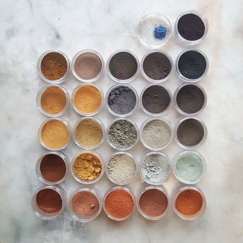A grid of powder pigments from natural sourcecs