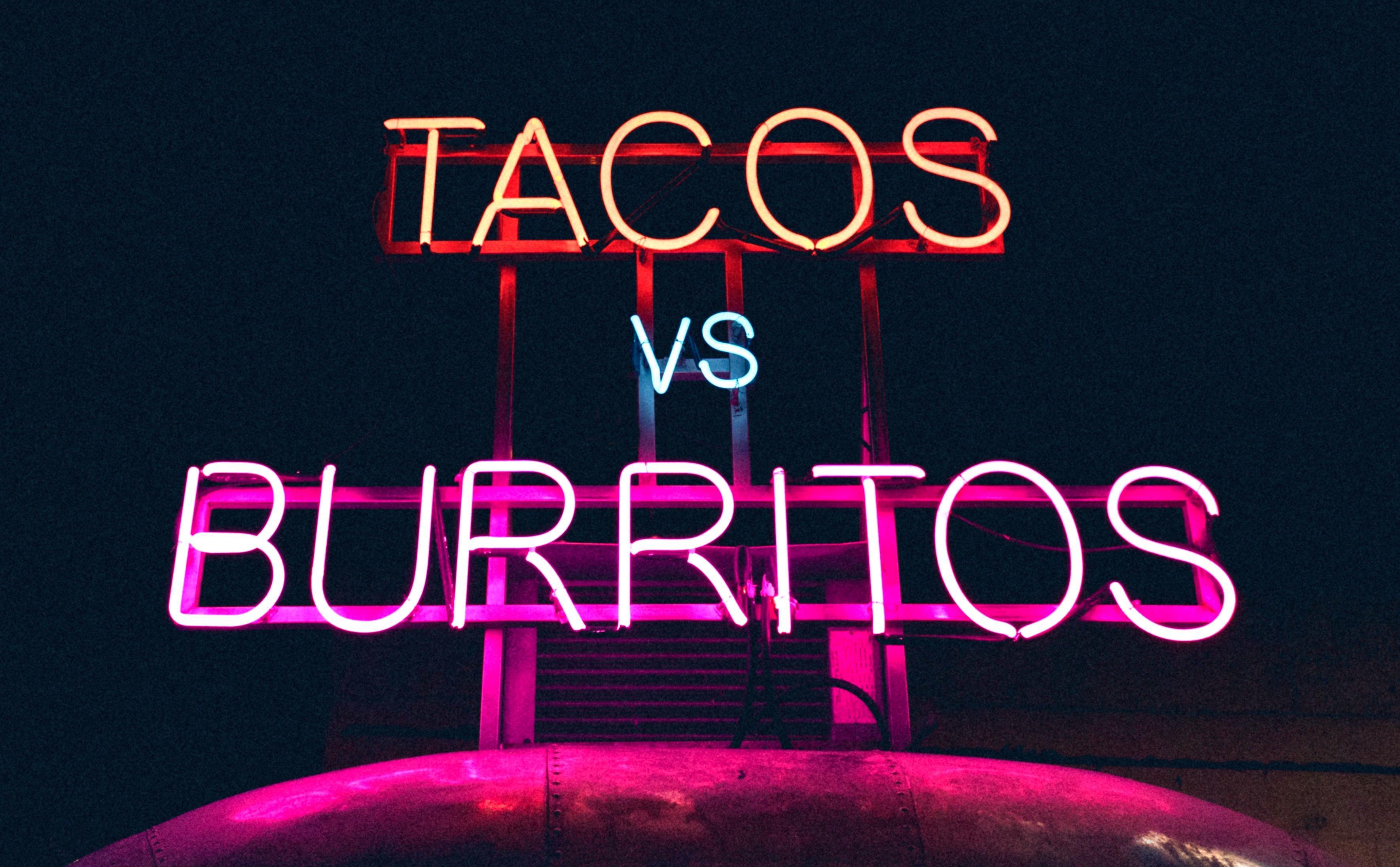 Tacos vs burrito sign