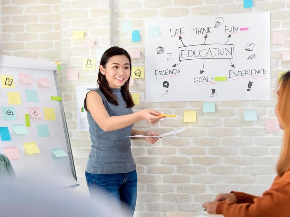 A teacher using a white board