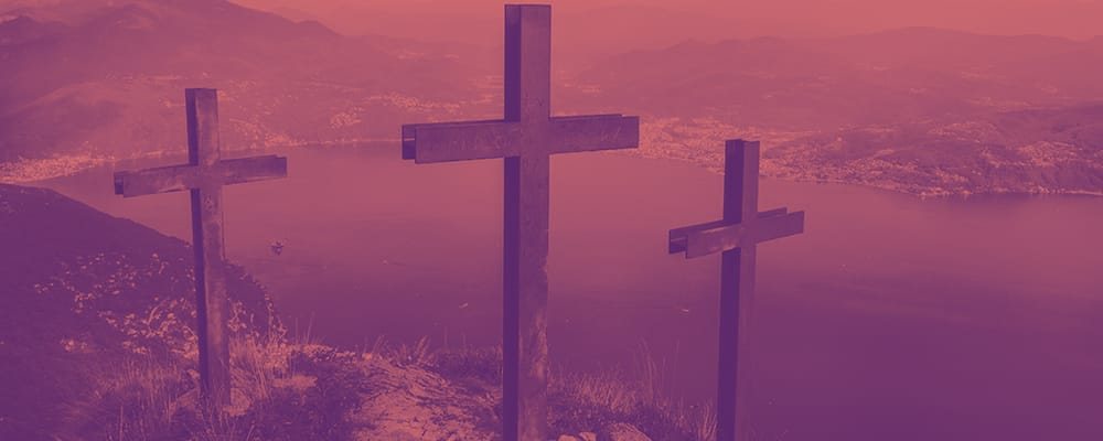 3 crosses on a hill overlooking the sea