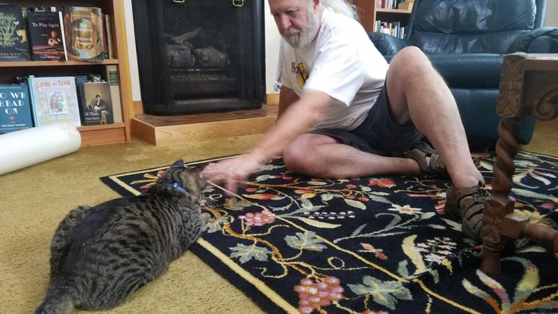 Tim getting his cat fix with Tom.