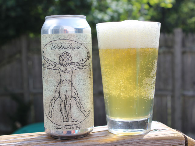 A 16oz can of Widowlager poured into a pint glass
