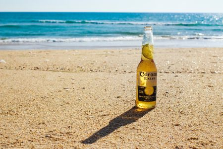 Corona beer bottle on a lonely beach