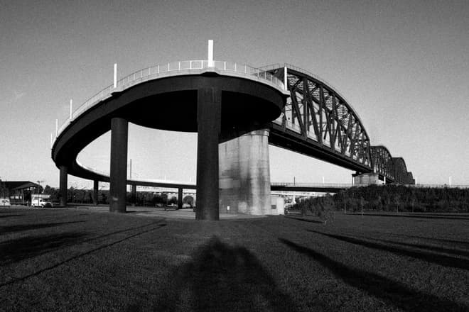 The spiral pedestrian ramp leading on to a steel footbridge crossing the Ohio River.