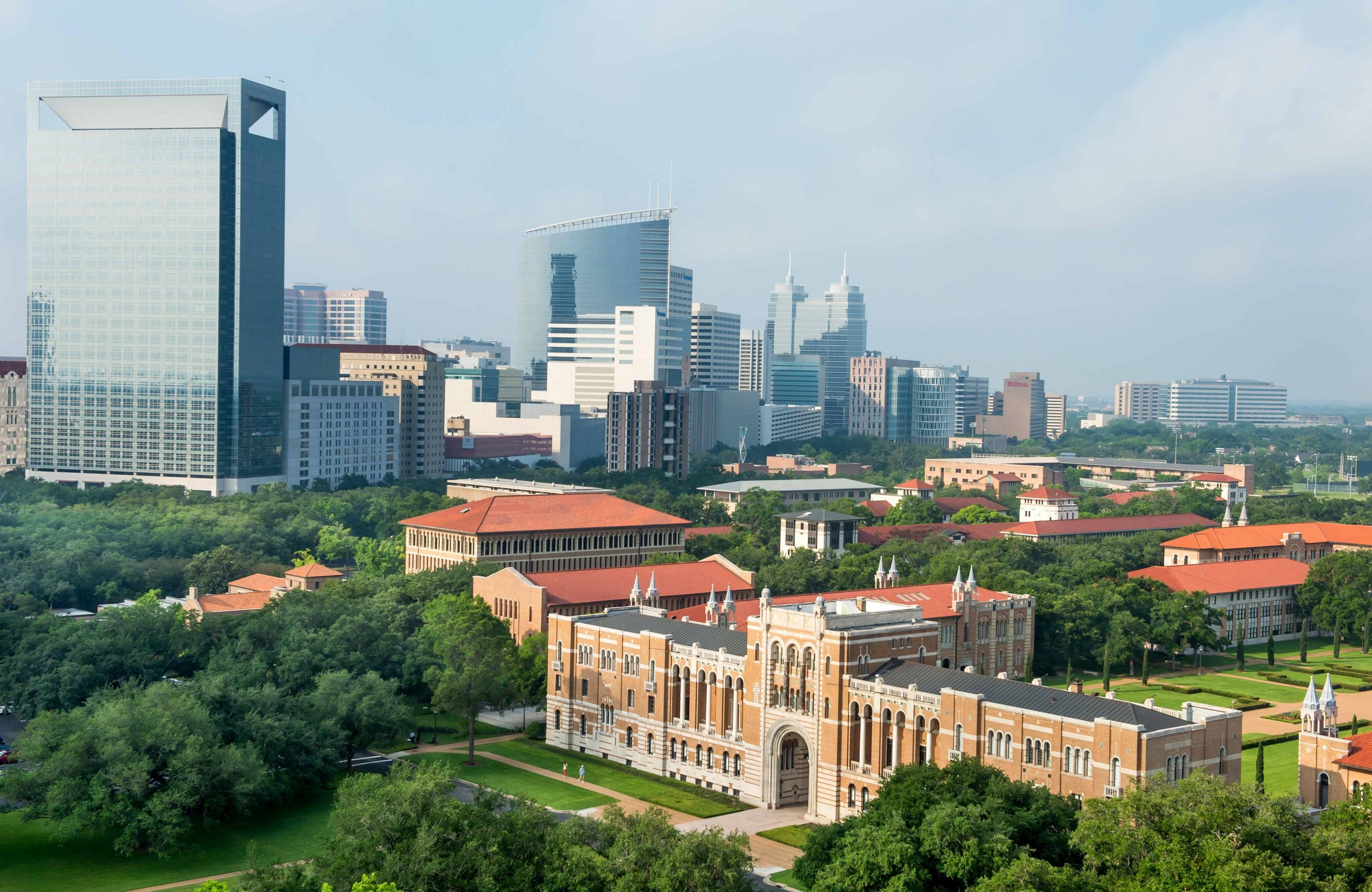 Aerial view of Rice University's Lovett Hall with tall buildings in the background
