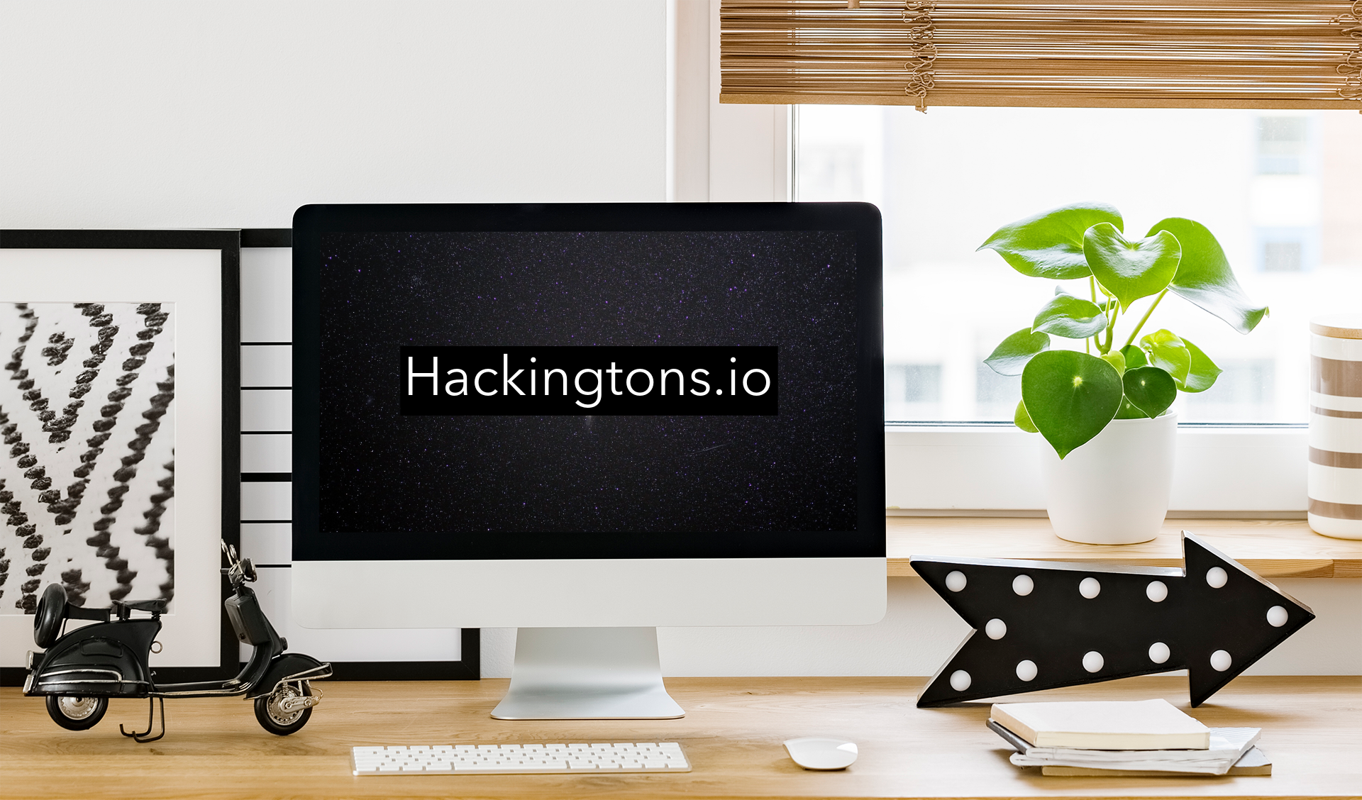 Hackingtons location in Pleasant Hill California.  6 desks with laptops infront of a large television.
