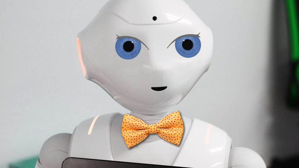 A white robot with blue eyes and a yellow bowtie is placed against a white background