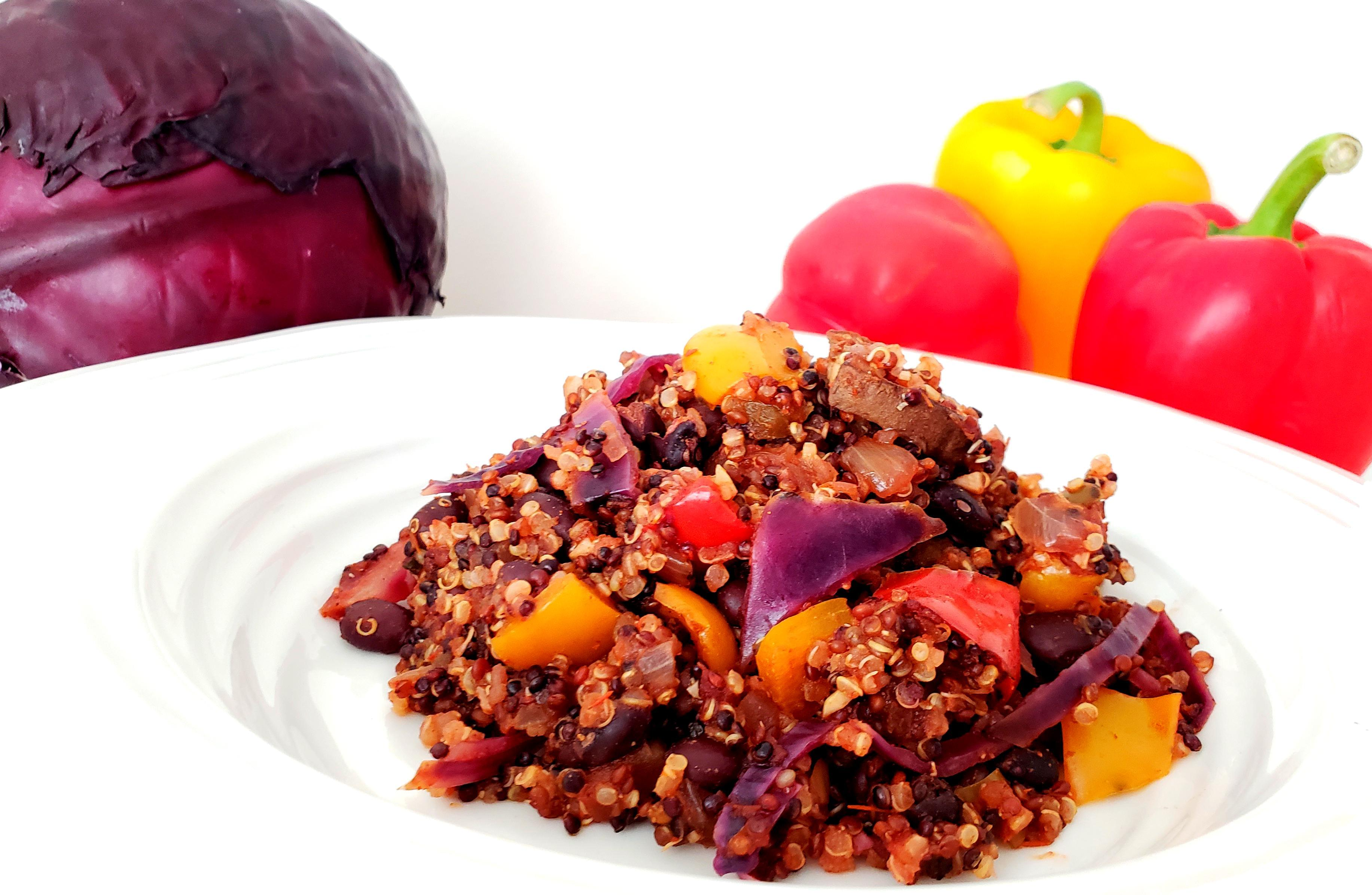 Cooked Mexican Quinoa with Peppers, red cabbage, and Mushrooms in bowl