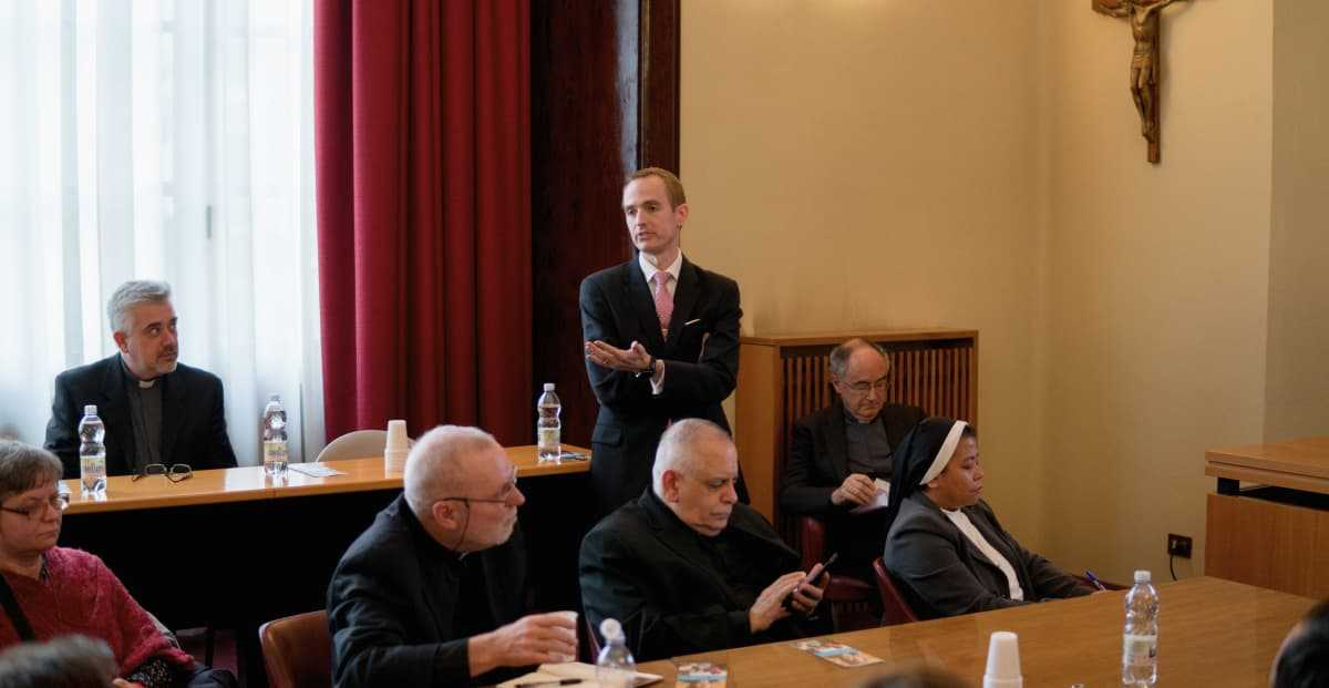 Matthew Sanders, CEO of Longbeard, presenting at the official website launch of the Migrants and Refugees Section at the Vatican. Cardinal Czerny and Fr. Fabio, leaders of the Section, in the background.