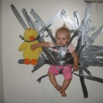 Baby duct-taped to a wall