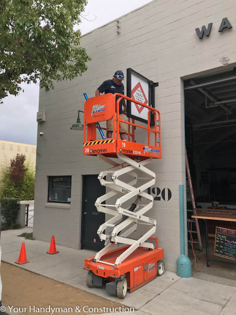 commercial sign installation with scissor lift