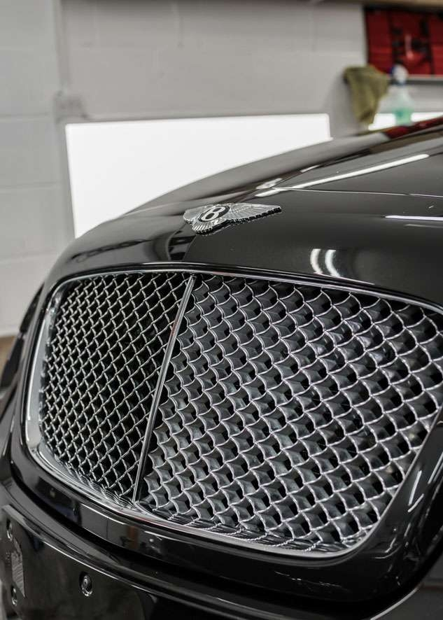 Shiny bonnet of Bentley Flying Spur car after polishing, paint correction and paint enhancement