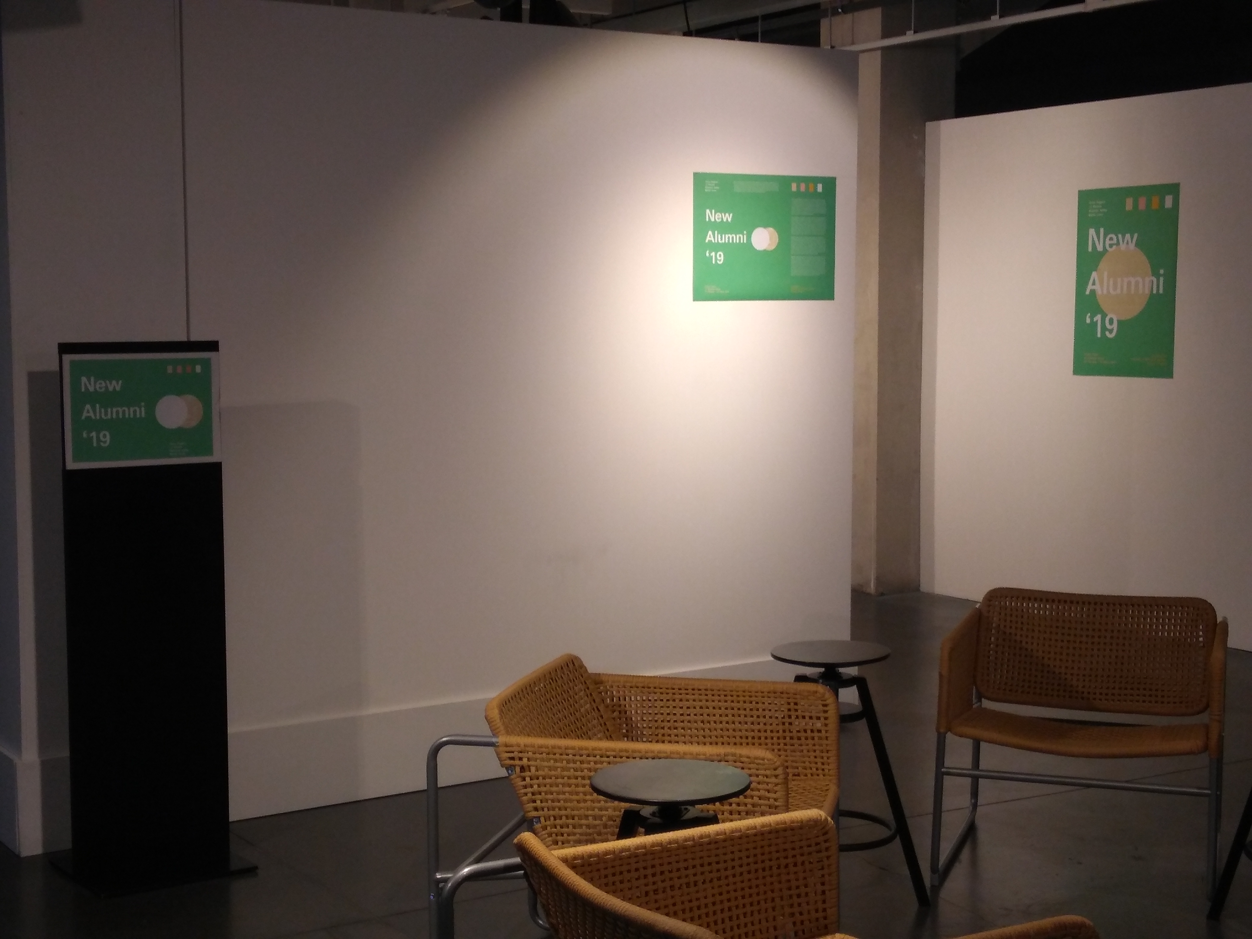 Seayting space before the entrance of the exhibition from which we can wee the exhibitoon signage and posters