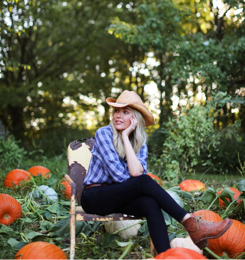 Sarah Frey sitting in a pumpkin field