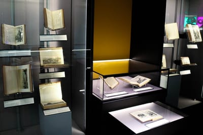 Showcases with several opened books on display.