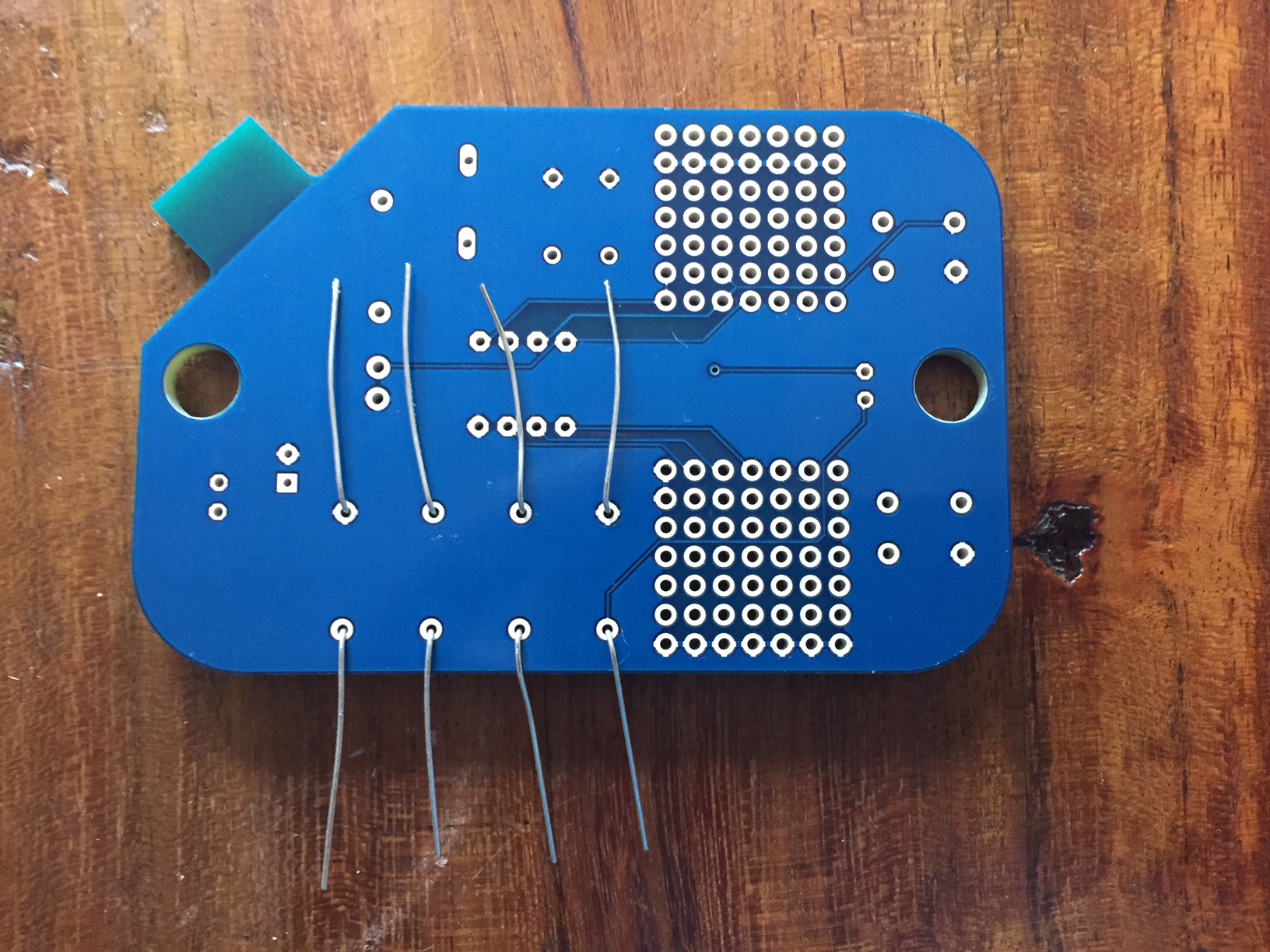 Resistor pins through board holes