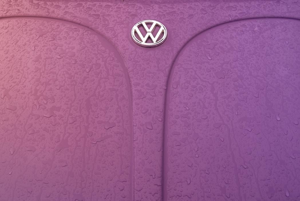 the wet hood of a Volkswagen vehicle, complete with the Volkswagen logo