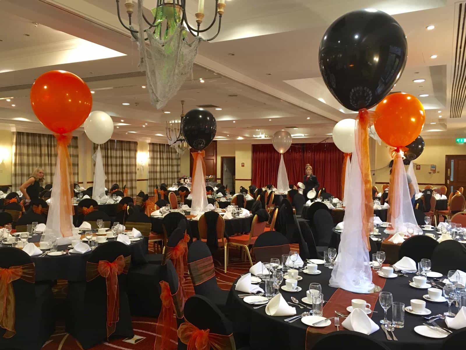 Haloween venue dressing event in Liverpool with black and orange decor all over the room