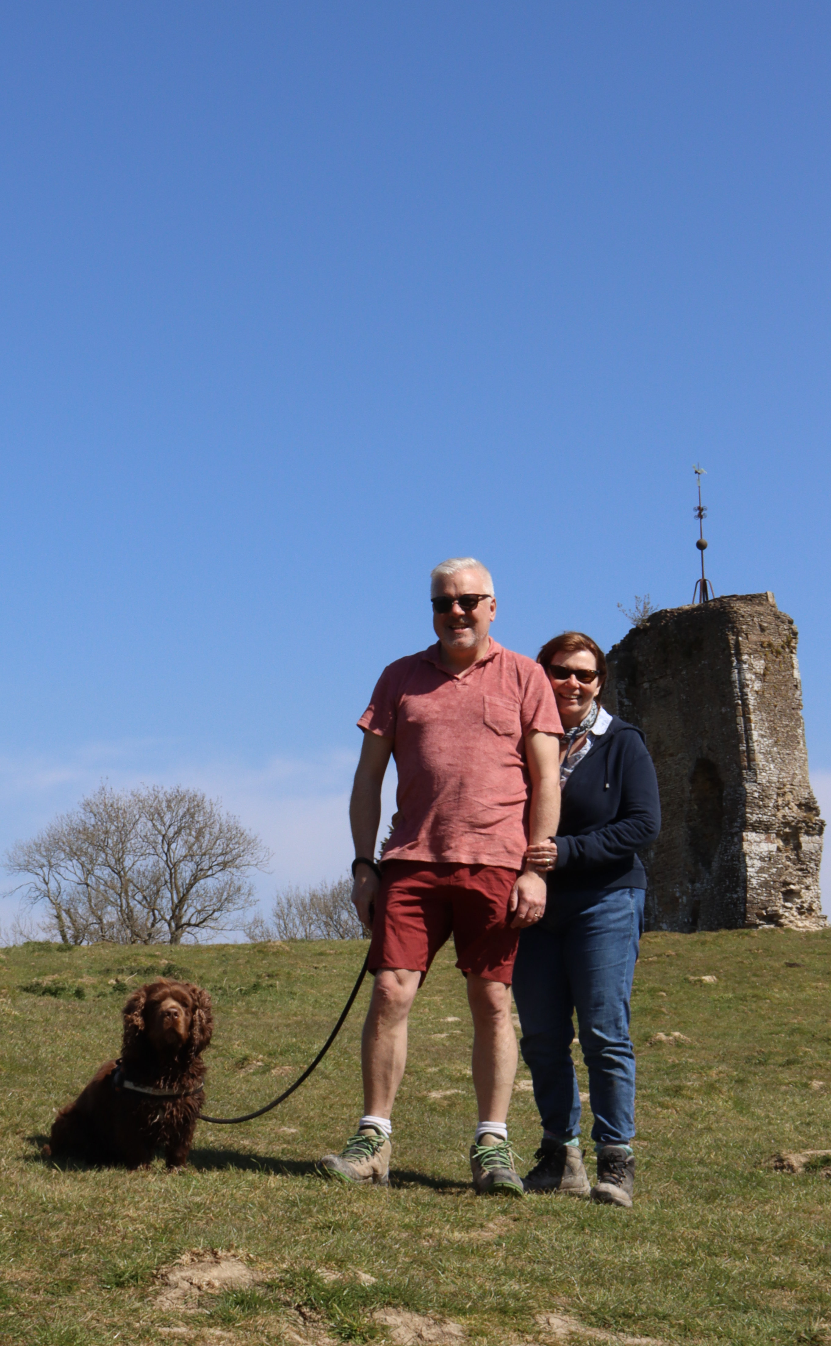 My parents and Bruno posing for a photo in front of Knepp castle