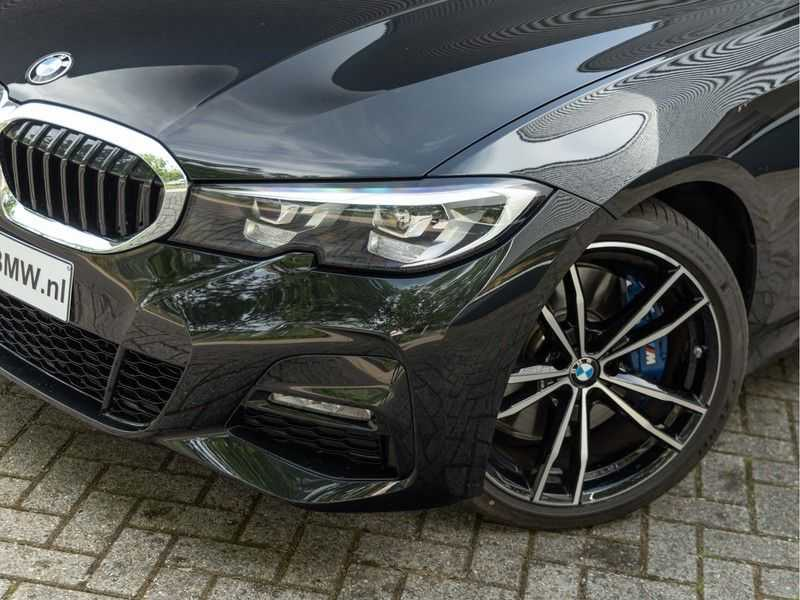 BMW 3 Serie Touring 330i M-Sport - Panorama - Trekhaak - Camera - Harman Kardon afbeelding 4
