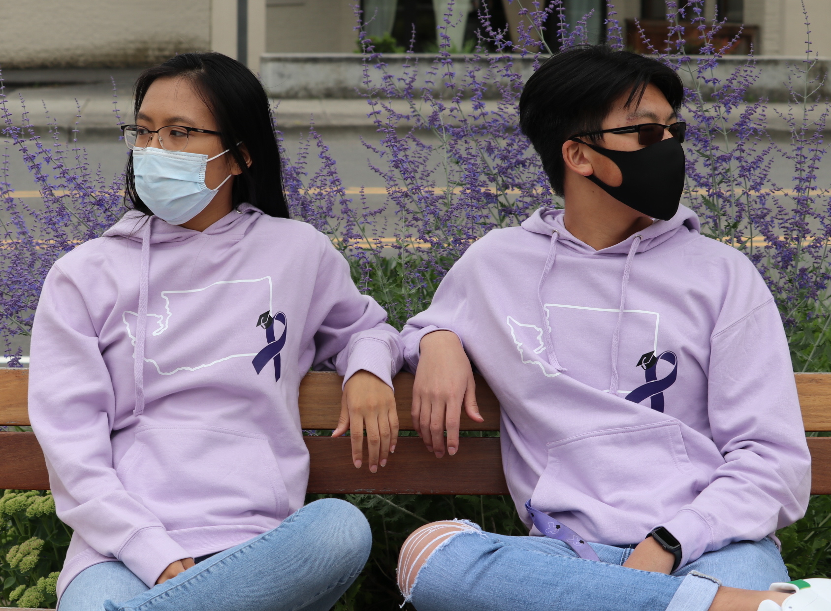 WASCAA Sweatshirts worn by students on bench