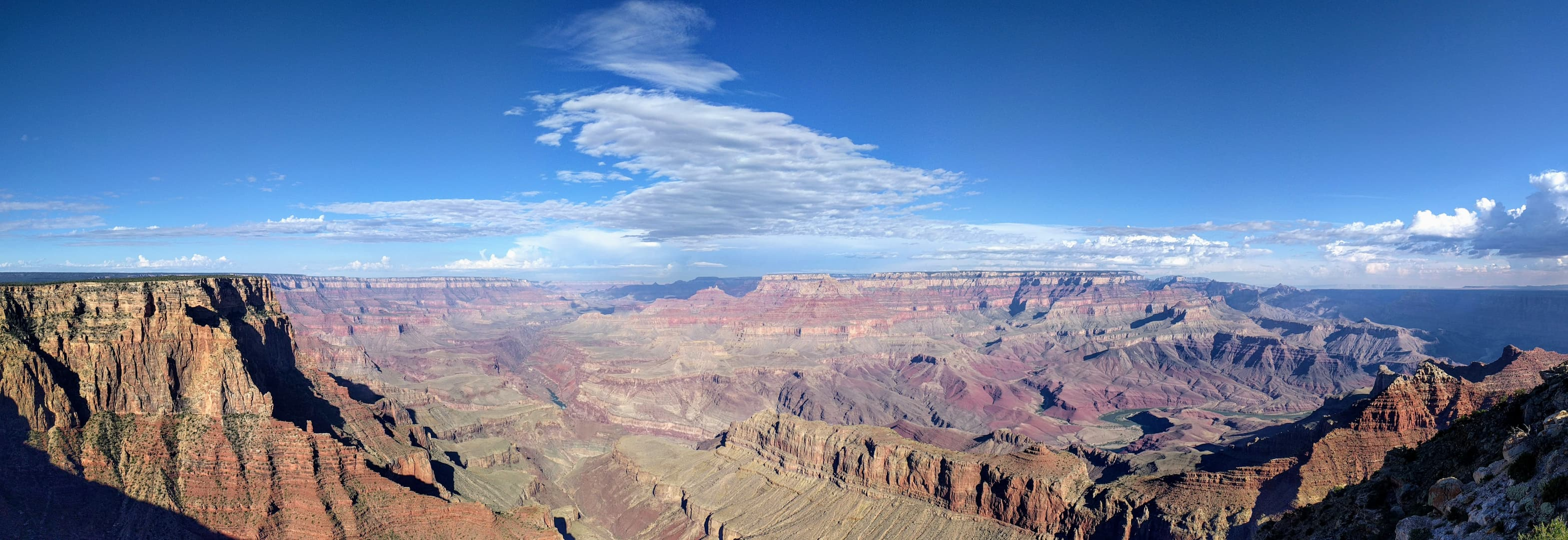 A view along the Grand Canyon from the South Rim, almost parallel to the Colorado River's course. The River itself is barely visible in a steep gorge near the center of the Canyon.