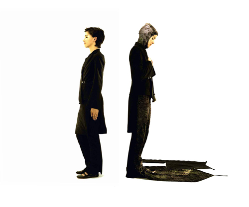 A photograph of the same woman, back to back: at left, in street clothes with a long blazer overcoat, and knee-length skirt over long pants in black. At right, the lower portion of the skirt unzips to become a prayer rug, and a head covering has been extracted from the blazer.